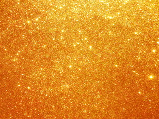 Christmas gold background. Golden holiday glowing glitter