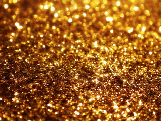 Christmas gold background, holiday glowing glitter