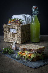 Vegan sandwiches for picnic with roasted carrots, pea spread, an