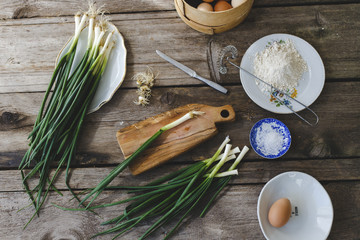 green onions on the wooden board