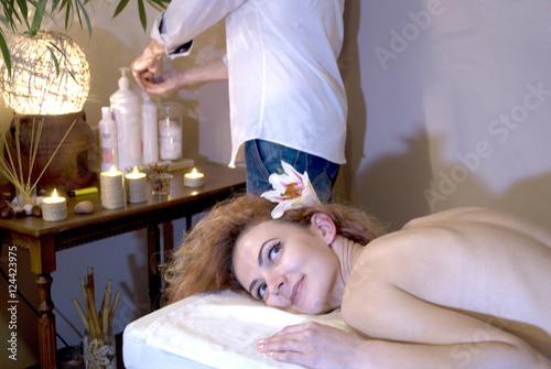 Portrait Of A Beautiful Relaxed Woman Laying On Massage Table