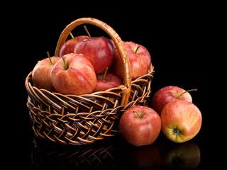 Crop of red apples in a wattle basket