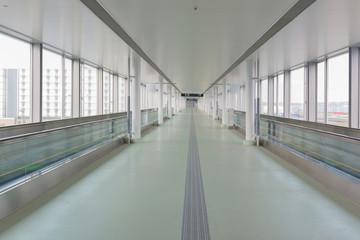 walkway with long horizontal escalator at international airport