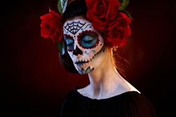 Woman in santa muerte mask eyes closed