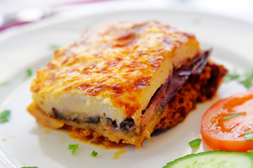 Greek style moussaka with eggplants, ground beef and potatoes. H