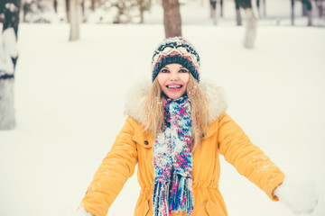 Young Woman wearing hat and scarf happy smiling outdoor enjoy winter snow Travel Lifestyle