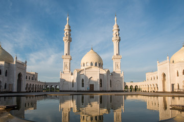 White mosque in Bolgar city with reflection in the water, Tatars