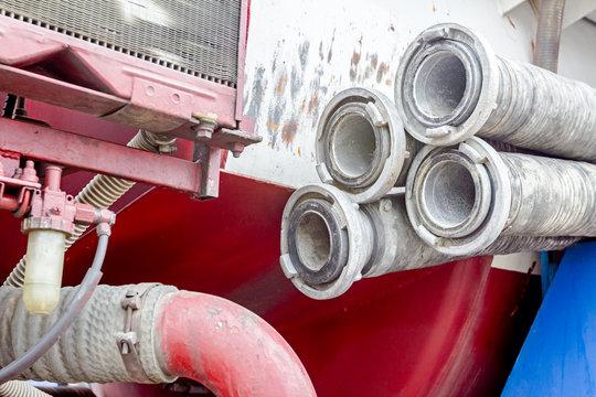 Coupler on corrugated suction hose