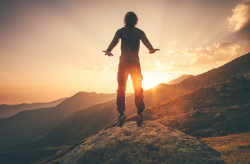 Young Man Flying levitation jumping in sunset mountains Lifestyle Travel concept outdoor