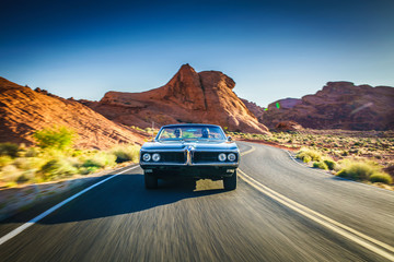 Wall Mural - driving fast through desert in vintage hot rod car