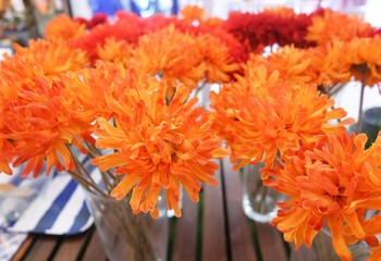Orange Artificial Gerbera Flowers in Glass Vase