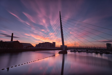 Sunrise at the River Tawe and the Millennium bridge in Swansea