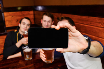 the guys at the bar doing selfie