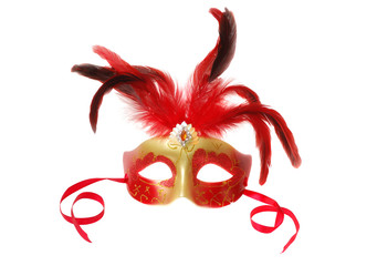 Red Venetian Carnival mask with feathers on the white