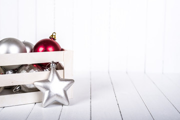 Christmas decoration over white striped background - selective focus, copy space