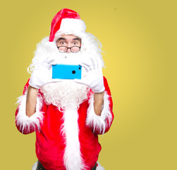 Santa Claus taking a photo with his cellphone