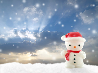 snowman lamp on snow hill with snow in sunset, christmas day concept