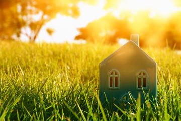 vintage house in the grass, garden or park at sunset light