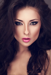 Beautiful woman with bright smokey makeup eyes and pink lipstick