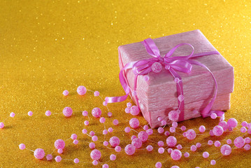 Pink box with gift on yellow background