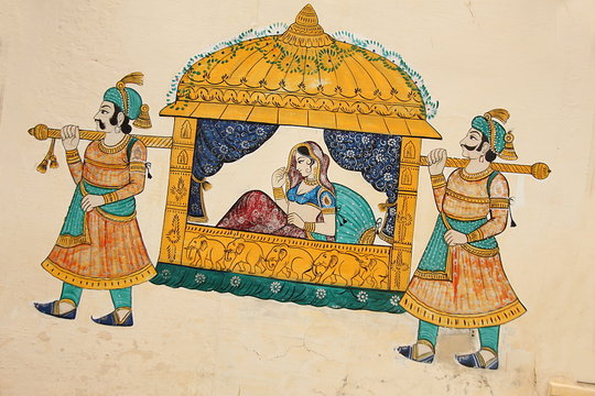 Traditional ancient wall painting of indian woman being taken