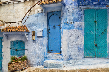 Typical street with ancient stone buildings in Chefchaouen medina in Morocco.