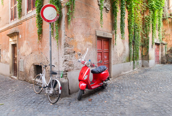 old town italian street with byke in Trastevere, Rome, Italy