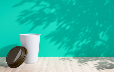 White disposable paper cup with lid on empty space background for mock up