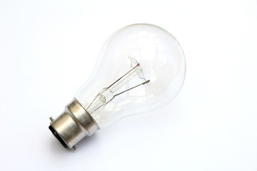 Incandescent tungsten clear B22 bayonet fitting light bulb isolated on white