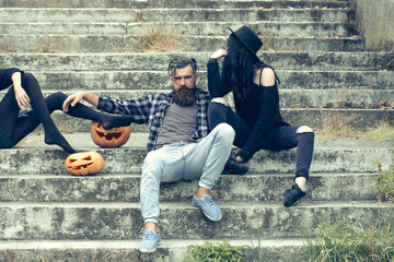halloween man and girls with pumpkin