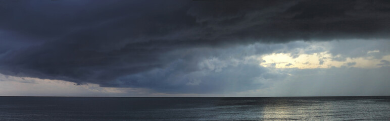 Heavy storm with dark clouds abow ocean