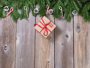 Christmas holiday wooden background with fir branches and gift