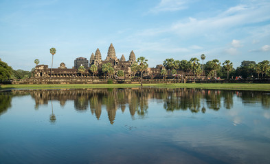 The reflection of Angkor wat is a temple complex in Cambodia and the largest religious monument in the world, with the site measuring 162.6 hectares.