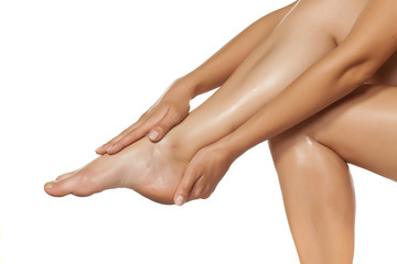 women applied the cream on her beautiful legs