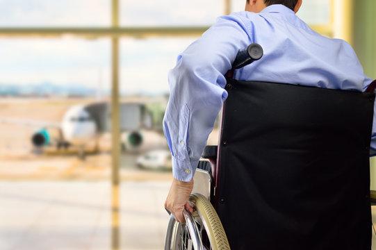 wheelchair businessman at airport