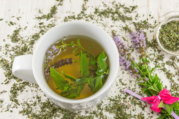 Mint tea with herbs in a teacup
