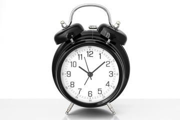 Black vintage alarm clock with white background