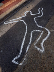 Outline of a body on road