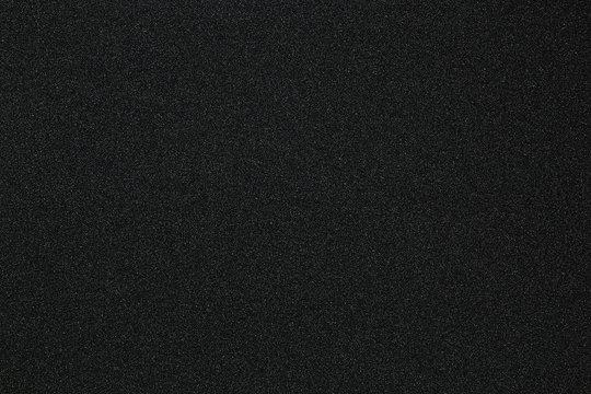 Black monotone grain texture. Glitter sand background.