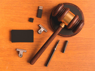 Judge's gavel, business card on wooden table. 3D illustration