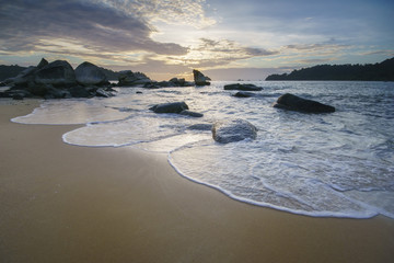 Beautiful seascape during sunset at Pasir Bogak beach, Pangkor Island with the wave on the beach.
