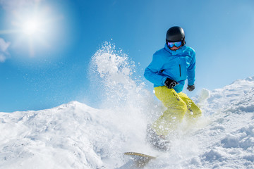 Active young man snowboarding
