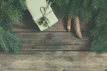 Christmas fir tree with decoration on dark wooden board. Coloring and processing photos