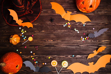Halloween holiday background with pumpkin and bats.