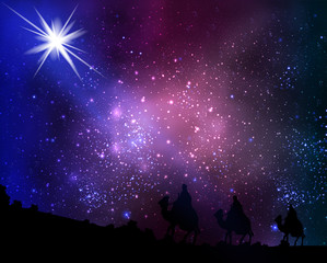 Three wise men on the background of cosmic sky and stars