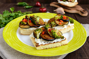 Fragrant Bruschetta with feta cheese, slices of eggplant and broccoli grilled.