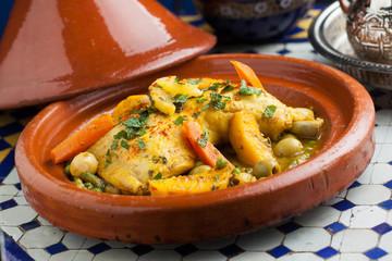 Morrocan food Tajine chicken vegetables lemon olives