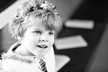 little kid boy in church on Christmas eve
