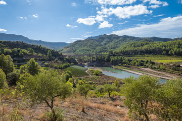 Railroad bridge pass the Pantà dels Guiamets, an important water supply in the region for the wine-growing area around Capçanes and Falset. Villages in the Montsant area in the cormaca Priorat