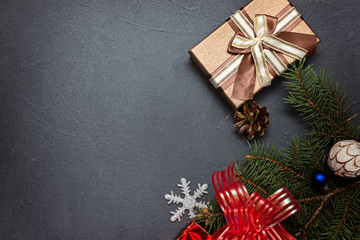 Christmas decorations and present on a dark  background